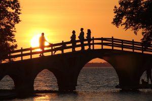 People standing on bridge