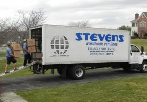 movers loading boxes into moving truck