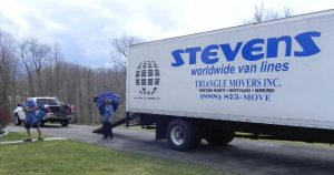 Triangle Workers unloading a moving truck
