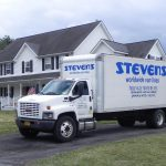 stevens van lines truck parked outside house