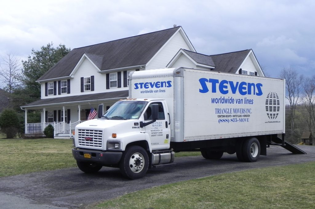 stevens worldwide and triangle movers truck outside house