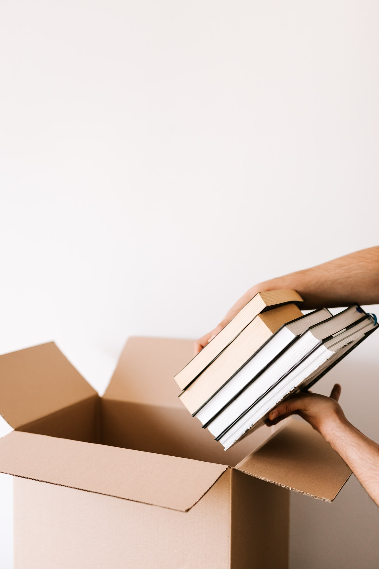 placing books in a moving box