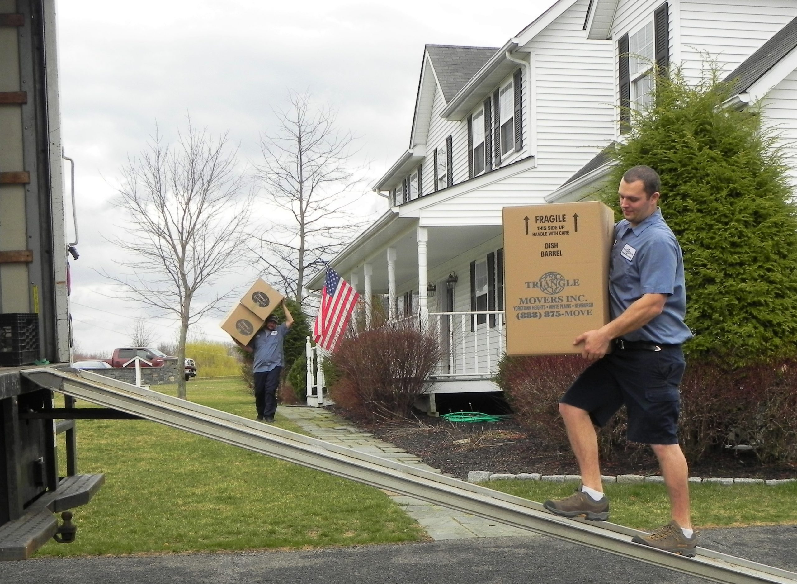 Triangle Movers loading a moving truck